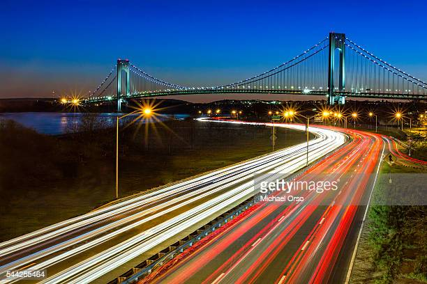 Traffic trails at night on the Belt Parkway in Brooklyn, NY. Verrazano–Narrows Bridge.