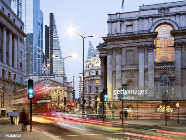 traffic trails through street of london - street light stock pictures, royalty-free photos & images
