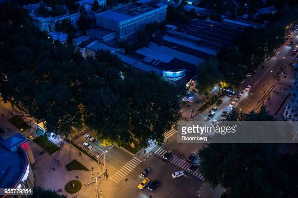 Traffic travels along a road as buildings stand illuminated at night in Dushanbe Tajikistan on Saturday April 21 2018 Flung into independence after...