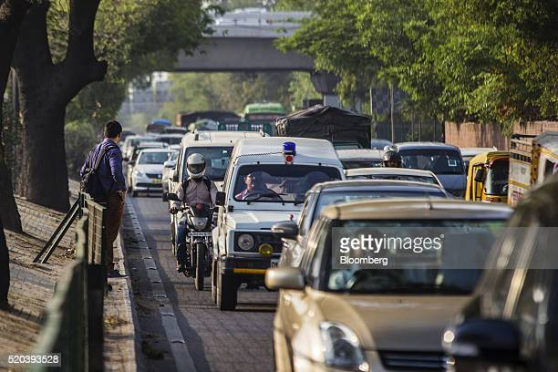 Traffic travels along a road in Delhi India on Friday April 8 2106 The oddeven car rationing plan is scheduled to return on April 15 as Delhi Supreme...
