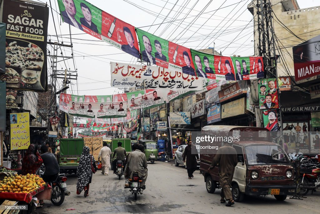 Traffic travels along a road past campaign banners for Pakistan TehreekeInsaf also known as Movement for Justice and Pakistan Muslim LeagueNawaz in...