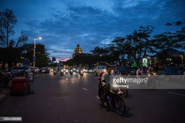 Traffic travels along a street at night in Phnom Penh, Cambodia, on Sunday, July 22, 2018. Asias longest-serving Prime Minister Hun Sen seeks...