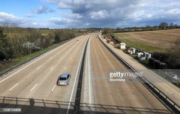 Traffic travels around the M25 motorway near Enfield, U.K., on Monday, March 30, 2020. EasyJet grounded its entire fleet after completing...