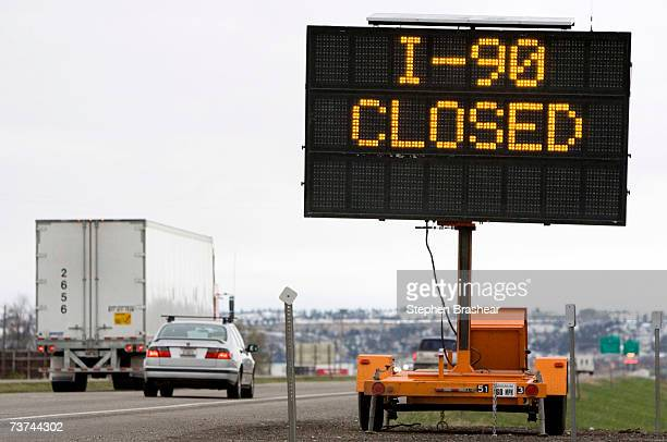 Traffic travels past a reader board indicating the closure of Interstate 90 at the MontanaWyoming border March 29 2007 in Billings Montana A spring...