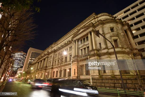 Traffic travels past the Bank of Japan headquarters in Tokyo, Japan, on Monday, March 11, 2019. An increasing number of economists see additional...
