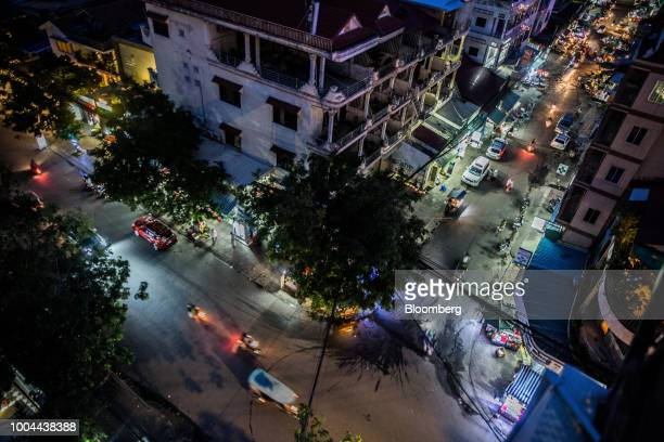 Traffic travels through the streets at night in Phnom Penh, Cambodia, on Sunday, July 22, 2018. Asias longest-serving Prime Minister Hun Sen seeks...