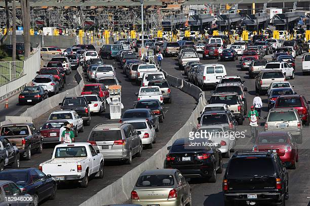Traffic waits to cross the border into the United States from Mexico on October 2 2013 in Tijuana Mexico Despite the US federal shutdown most US...