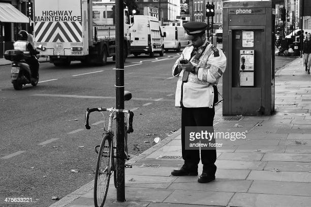 Traffic warden drinks too much coffee and gets busy on the streets of London.