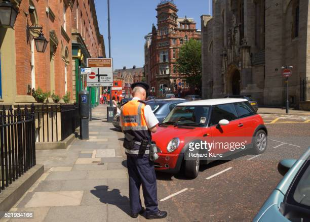 Traffic Warden Issuing Ticket in Leeds