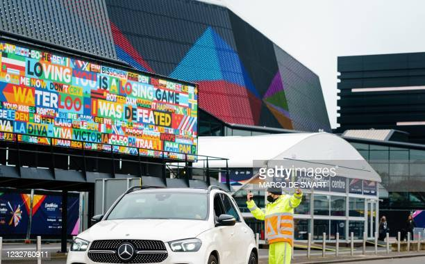 Traffic warden speaks with a motorist outside Ahoy convention centre, where the first participants in the Eurovision Song Contest rehearse in...