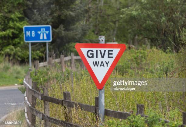 traffic warning signs between glasgow edinburgh road highway in scotland uk england - give way stock pictures, royalty-free photos & images