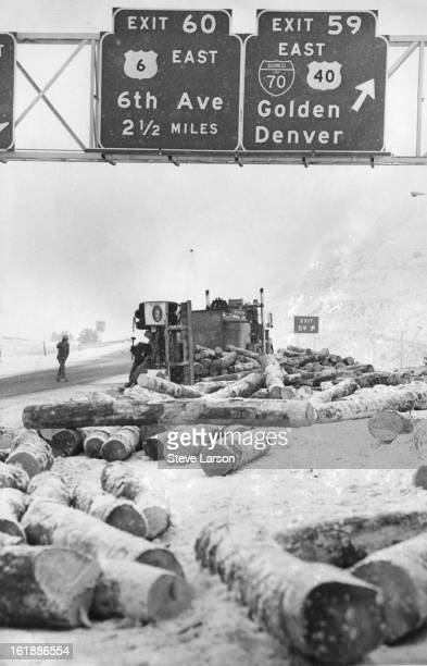 MAR 12 1975 MAR 13 1975 Traffic was slowed for 30 minutes Wednesday morning on Interstate 70 near the Morrison exit west of Denver when this logging...