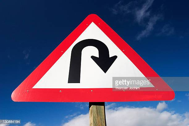 Traffic-Shield Listen Sharp Turn in front of blue sky (South-Africa).
