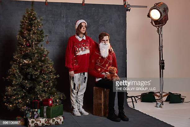 Tragic couple poses for holiday card photo.