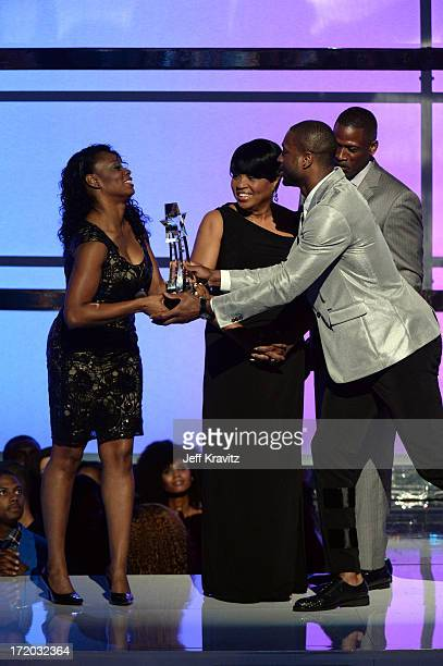 Tragil Wade Jolinda Wade Dwyane Wade Sr and Dwyane Wade appear onstage during the 2013 BET Awards at Nokia Theatre LA Live on June 30 2013 in Los...