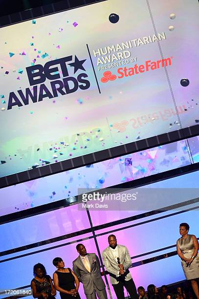 Tragil Wade Jolinda Wade Dwyane Wade Sr NBA player Dwyane Wade and Chairman and CEO of BET Networks Debra Lee onstage during the 2013 BET Awards at...