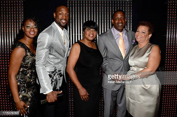 Tragil Wade NBA player Dwyane Wade Jolinda Wade Dwyane Wade Sr and Chairman and CEO of BET Networks Debra Lee pose backstage during the 2013 BET...