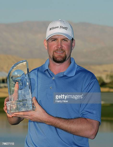 J Trahan smiles with the trophy after winning in the fifth round of the 49th Bob Hope Chrysler Classic at the Classic Club Course on January 20 2008...