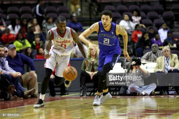Trahson Burrell of the Memphis Hustle handles the ball against Brandon Ashley of the Texas Legends during an NBA GLeague game on January 29 2018 at...
