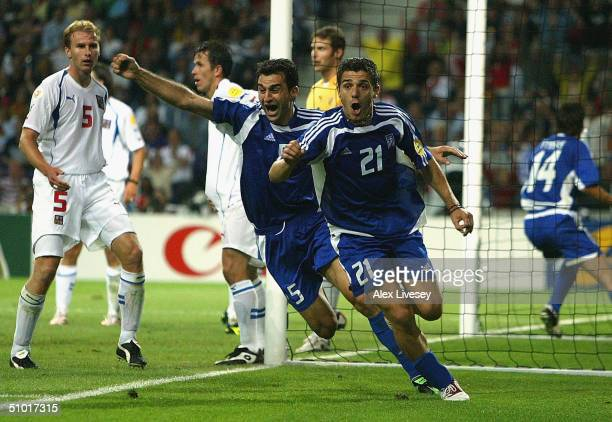 Traianos Dellas of Greece celebrates with Konstantinos Katsouranis after scoring the winning goal during the UEFA Euro 2004 Semi Final match between...
