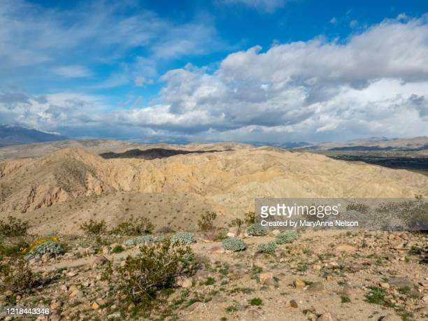 trail above san andreas fault with distant mountains - indio california stock pictures, royalty-free photos & images