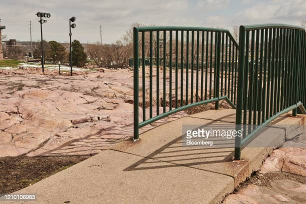 A trail in Falls Park stands empty of visitors in Sioux Falls South Dakota US on Wednesday April 15 2020 South Dakota Governor Kristi Noem has argued...