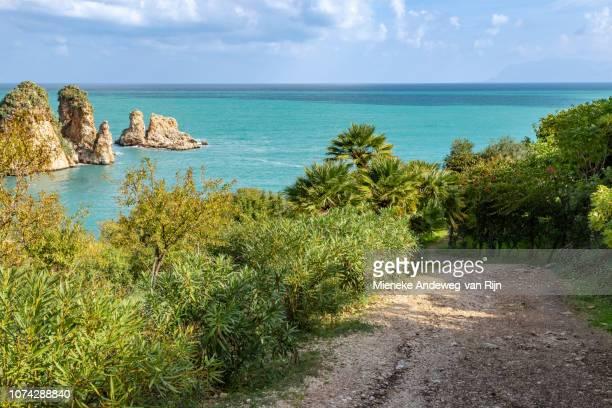 Trail leading to Tonnara di Scopello, a limestone cove on the Gulf of Catellammare, Scopello, Trapani, Sicily, Italy
