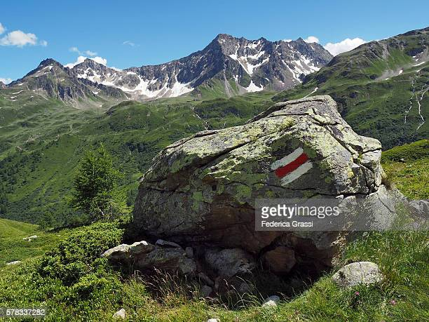 Trail Marker Painted On Granite Boulder In The Lepontine Alps, Ticino, Switzerland