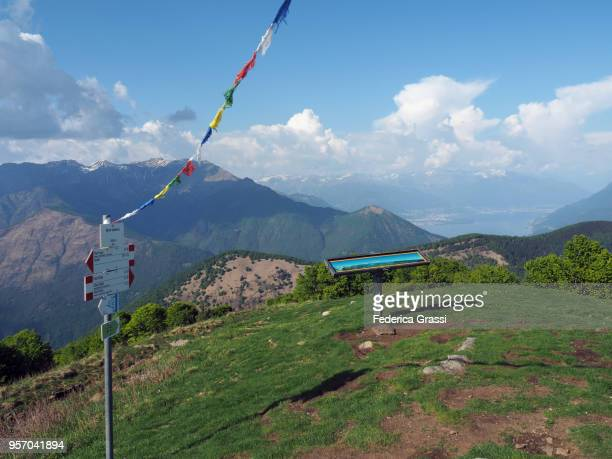 trail markers and tourist billboard on top of monte spalavera - nepali flag stock pictures, royalty-free photos & images