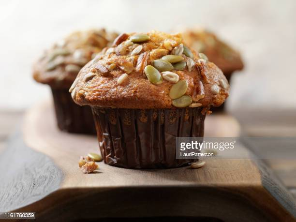 trail mix carrot muffin with nuts and seeds - muffin stock pictures, royalty-free photos & images