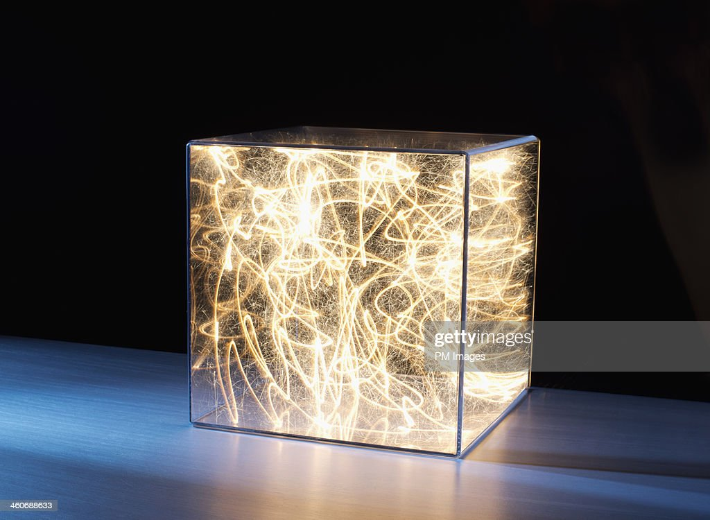 Trail of bright light in box : Stock Photo