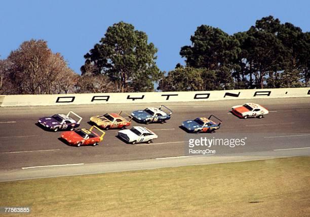 A trail of winged Dodge Daytonas and a couple of Fords make their way around Daytona International Speedway during the 1970 Daytona 500 in Daytona...