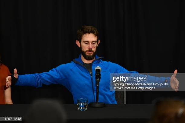 Trail runner Travis Kauffman explains the size of the mountain lion during the press conference at Fort Collins Marriott hotel Feb 14 2019 Kauffman...