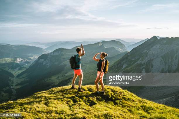 trail runners ascend high mountain ridge - switzerland stock pictures, royalty-free photos & images