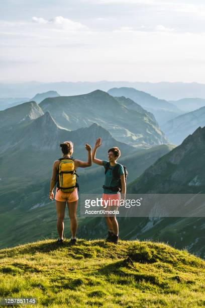 trail runners ascend high mountain ridge - active lifestyle stock pictures, royalty-free photos & images