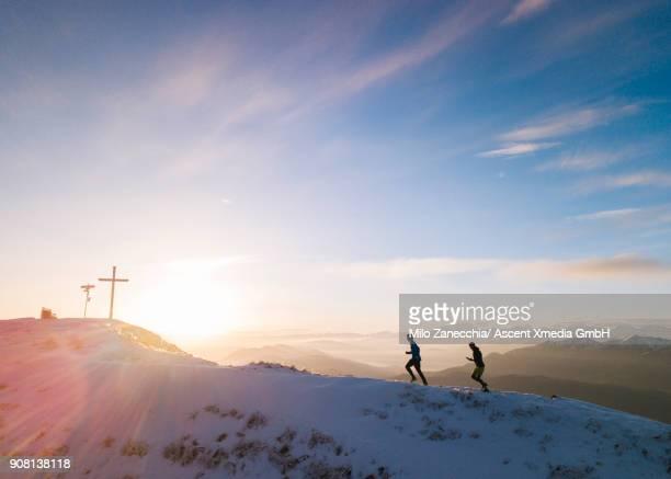 Trail runners ascend ridge, nearing summit