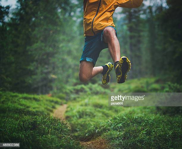 trail running big jump - vitality stock pictures, royalty-free photos & images