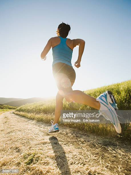 trail running - mid adult stock pictures, royalty-free photos & images