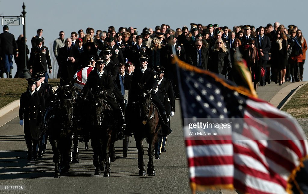 Trailed by family and friends, a horse drawn caisson carries the casket of U.S. Army Capt. Andrew Pedersen-Keel during a burial service at Arlington National Cemetery March 27, 2013 in Arlington, Virginia. Capt. Pedersen-Keel was killed on March 11, 2013 while serving in Wardak Province, Afghanistan from injuries sustained when attacked by small arms fire from a man in an Afghan police uniform, according to reports.