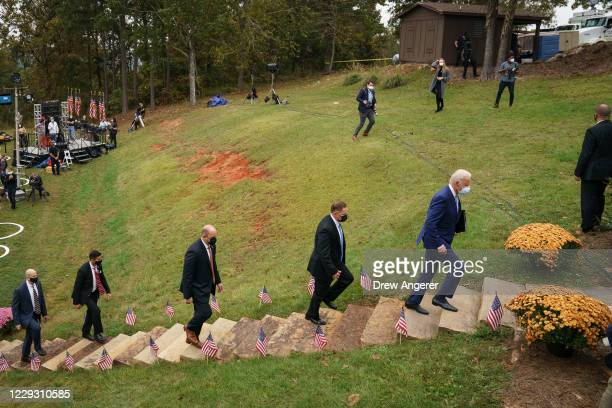 Trailed by US Secret Service agents Democratic presidential nominee Joe Biden leaves a campaign event at the Mountain Top Inn and Resort on October...