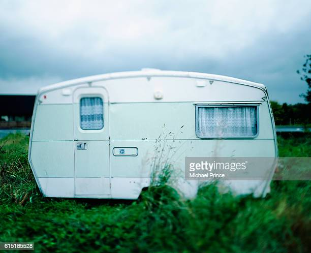 Trailer Home in Overgrown Field