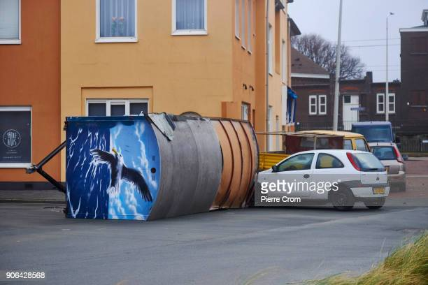 A trailer is knocked down on a car as a hurricaneforce storm blows galewinds up to force 12 on January 18 2018 in The Hague Netherlands The Dutch...