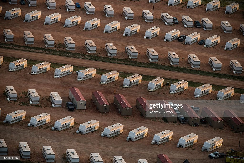 A trailer park occupied mostly by oil workers is seen in an aerial view in the early morning hours of July 30, 2013 near Watford City, North Dakota. North Dakota has seen a boom in oil production thanks to new drilling techniques including horizontal drilling and hydraulic fracturing.