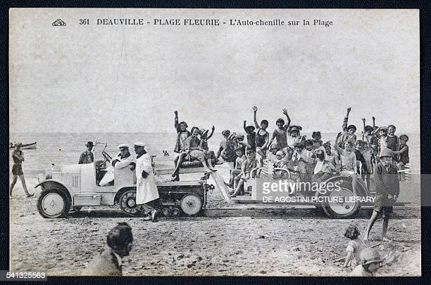 A trailer towed by a tracked Citroen on the beach in Deauville postcard 1920s1930s France 20th century
