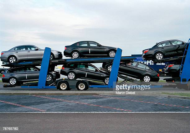 trailer truck carrying cars - carrying stock pictures, royalty-free photos & images