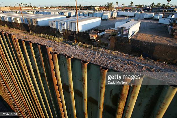 A trailer yard in the United States as seen from Mexico over the top of the USMexico border fence March 25 2005 between Mexicali Mexico and Calexico...