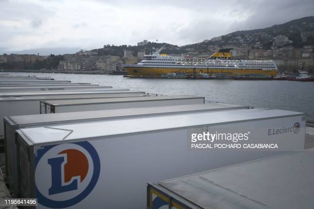 Trailers are parked in the port of Bastia on the French Mediterranean island of Corsica on January 24 2020 with the Mega Express ferry from Italian...