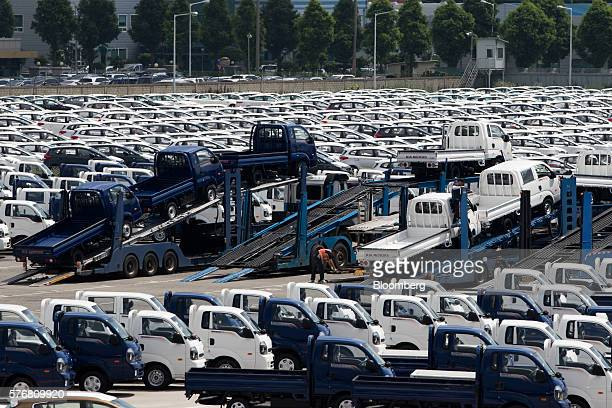 Trailers carrying Kia Motors Corp porter trucks are parked at the company's delivery center in Gwangju South Korea on Friday July 8 2016 South Korea...