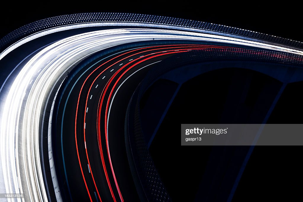 Trails for a traffic light on a black background : Stock Photo