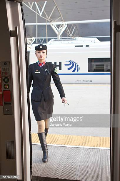 CRH train a beautiful female conductor walking into the car